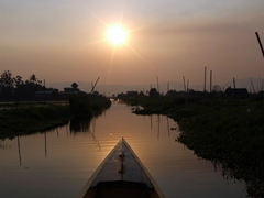 Sunset over a village on Inle Lake
