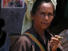 Pa-O tribal lady smoking a cheroot; Heho market