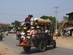 A full taxi makes its way to drop off passengers from Heho market