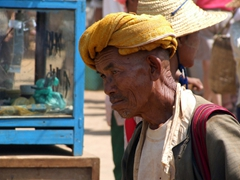 Close up of a local vendor selling his goods; Heho market