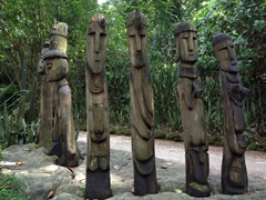 Carved wooden statues capture our attention in this section of the Singapore zoo
