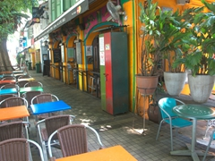 A colorful street side bar where the drink prices are quite reasonable; Bali Lane