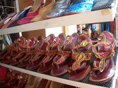 Colorful leather sandals for sale on Bussorah Street in Kampong Glam, where Singapore's Arab immigrants settled. This street was known for sandal-making, copper craft and brassware
