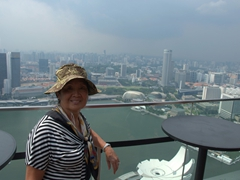 Ann smiles for the camera while taking a break from admiring the views from the rooftop of Marina Bay Sands