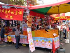 Street vendors sell the famous moon cake during the Mid-autumn festival