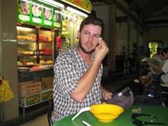 Robby sweating it out after a spicy soup, Hawker Stall