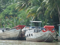 "Boats on the Mekong Delta are all painted with ""Mekong Eyes"" to bring the owners good luck and a wide awake crew"