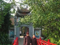 Two nuns on the Huc Bridge, Hanoi
