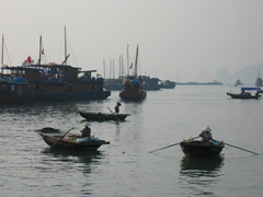 Small boat owners hustling for business, Ha Long Bay