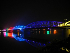 Hue's bridges are beautifully lit at night, rotating colors at periodic intervals