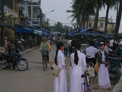 Young girls wearing white Ao Dai (traditional Vietnamese dresses), Hoi An