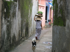 Traditional scenes such as this are common even in touristy towns such as Hoi An