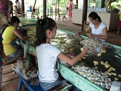 Coconut candy being hand rolled at a factory in My Tho