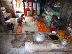 This entrepreneurial couple makes a decent living selling rice wine. Here, they demonstrate how the strong brew is created