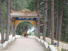 What an incongruous sight! A monks zooms off on a motorcycle; outskirts of Dalat