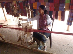 A Koho minority woman demonstrating how she makes tablecloths; Lang Dinh An (Chicken Village)