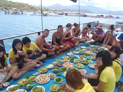 A sumptuous lunch is spread out and shared amongst all the guests; Mama Linh party boat