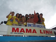 Robby posing next to a friendly group of Vietnamese students on the Mama Linh boat; Nha Trang