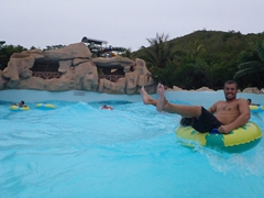 Robby hanging on in the wave pool; VinPearl Park
