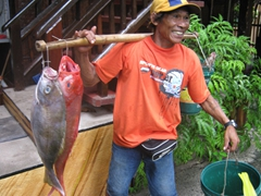 A happy fisherman sells his fresh catch of the day at a great price; Orchid Resort on Boracay