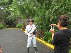 Becky takes a photo of a colonial garbed guard inside the walled city of Intramuros; Fort Santiago