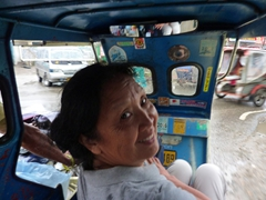 Ann smiles as she gets jostled around in our tricycle; Boracay