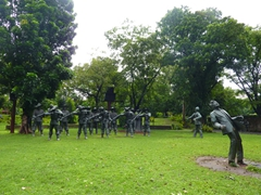 A statue reenactment of Dr José Rizal's final seconds as his life is ended by firing squad; Rizal Park