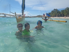 Smiling after a bangka slowly made its way over us; White Beach