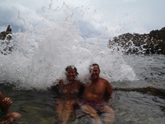 Getting slammed by incoming waves at a natural pool; Ariel's Point
