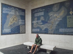 "Robby soaking in the mosaic map of Iwo Jima after having read ""Flags of our Fathers"""