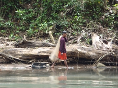 A fisherman carrying his net along the river; Pagsanjan Falls