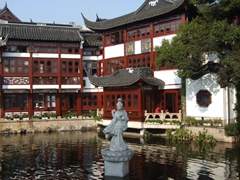 A lone figurine in the artificial moat surrounding the Yuyuan garden