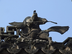 Detail of a fighting warrior figurine; Yuyuan Garden