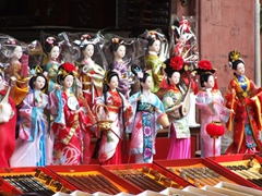 Close up of Chinese dolls for sale; Yu Gardens Bazaar