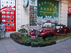 Anything to capture one's attention! An old vehicle catches our eye on Nanjing Lu