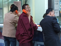 Pay phone centers are popular...for monks too!