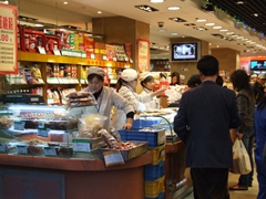 Hustle and bustle of Nanjing Lu's deli stores