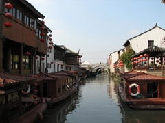"It seemed that almost every boat and house along Suzhou's canal system had to hang ""obligatory"" red lanterns"