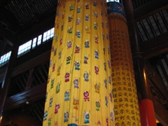 Cloth draperies hang from the ceiling of the Jade Buddha Temple