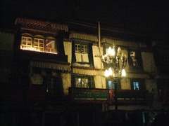 We joined the pilgrims circumnavigating the Jokhang temple at night and passed by pretty, Tibetan style buildings such as this