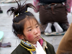 This rosy red cheeked girl caught our eye; Jokhang Square