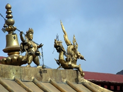 Close up of the intricate statues adorning Jokhang Temple's roof