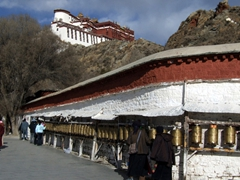 Pilgrims circumnavigate around the Potala Palace