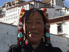 An Amdo woman proudly poses for the camera