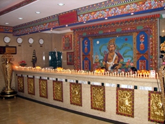 The ShangBaLa hotel's reception desk is lined with candles in celebration of the Lamp Festival