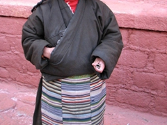 Portrait of an Amdo woman (check out the huge chunks of coral and turquoise braided into her hair!)