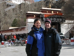 Posing with the Potala Palace high above us