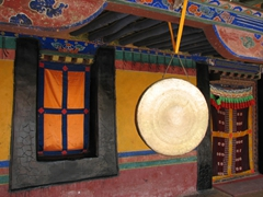 A large drum hangs from the rafters of Jokhang Temple
