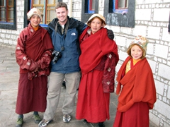 Robby hugs his monk friends; Barkhor District