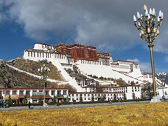 A brilliant ray of sun lights up the entire Potala for a brief minute